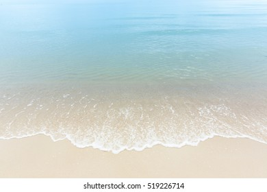 Close up blue sea water waves on white sand beach,Beautiful blue sea beach with white sand, Clean beach with blue sea in Thailand