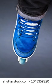 Close up of a blue shoes roller in a skate park