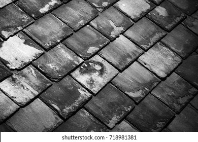 Close up of blue slate tiles on a roof