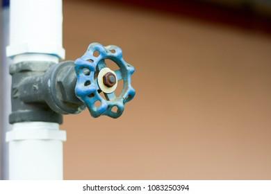 close up blue spigot outdoor