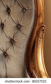 close up of blue velvet chair with wooden arms