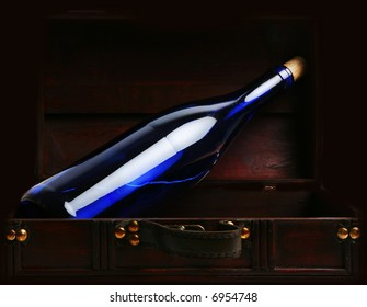close up of blue vine bottle with cork in vintage box