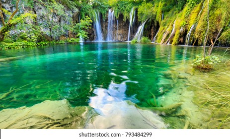 Close up of blue waterfalls in a green forest during daytime in Summer.Plitvice lakes, Croatia