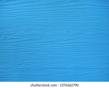 Close up blue wood substitute board and high quality of fiber board  texture and background for concept design and decoration, Beautiful wooden plank patterns from cement striped wood wall