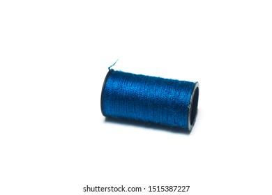 Close up Blue yarn on spool, yarn on tube