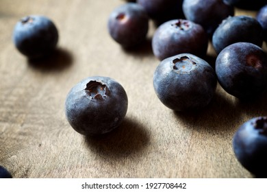 Close up of a blueberries ion a wood table.