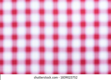 Close up of a blurred red and white cross pattern and texture, as chess table. Red and white chess table.