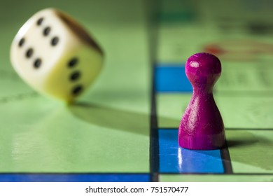 Close up of a board game with pawn and  rolling dice