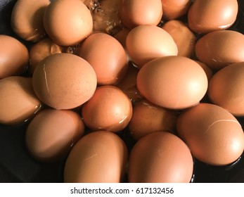 Close up boiled eggs in the pan.