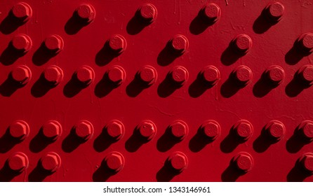 Close up of bolts and nuts painted red