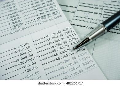 Close up book bank statement with pen. Saving account passbook. Selective focus.
