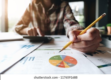 Close up of bookkeeper or financial inspector hands making report, calculating or checking balance. Home finances, investment, economy, saving money or insurance concept