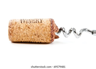 close up of bottle opener and cork of wine bottle on white