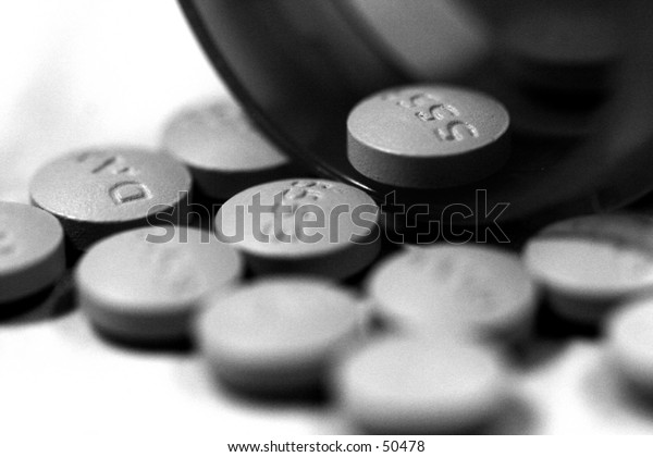 Close Up of Bottle and Pills