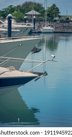 Close up of the bow of a luxury boat with anchor on deck and water reflections