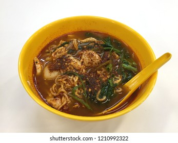 "close up of a bowl of ""maggi mee"" curly noodle tomyam soup"