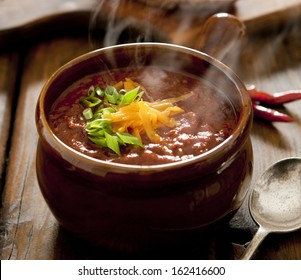 Close up of a bowl of steaming hot chili con carne.