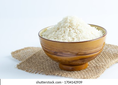 Close up a bowl of uncooked long grain white rice