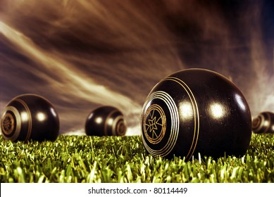 Close up of  bowling balls on an open bowling field at sunset
