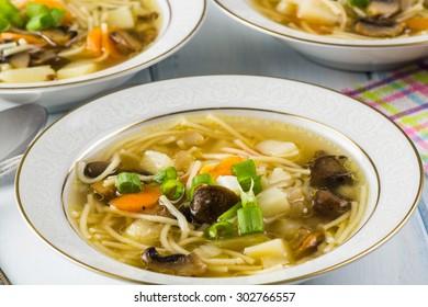 Close up of bowls of mushroom soup.