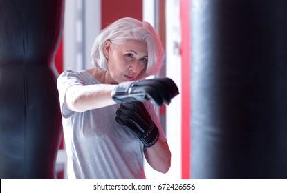 Close up of boxing elderly lady