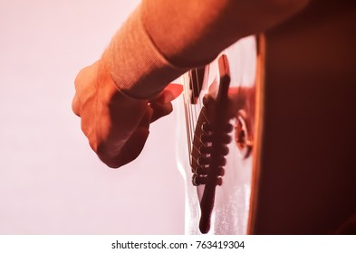 Close up of boy playing a guitar
