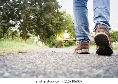 close up of boy shoes walking on the street in the evening