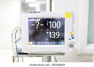Close up of BP, Vital sign and Heart rate monitor in hospital.Electrocardiographic (ECG) Monitoring Medical Device in Operation Room