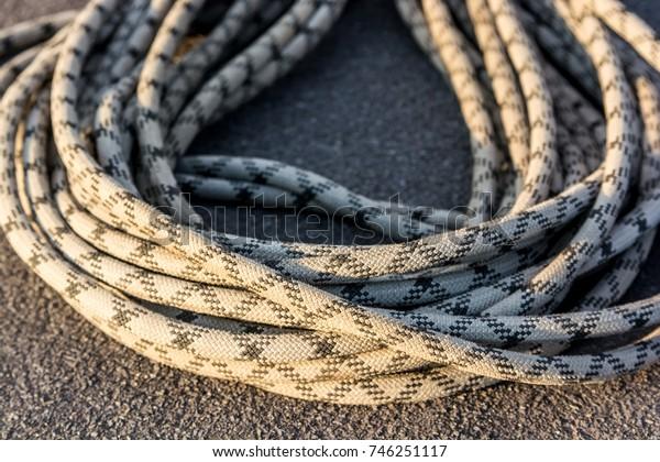 Close up braided climbing rope on asphalt