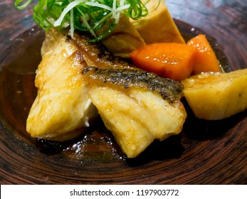 Close up braised fish in brown sauce