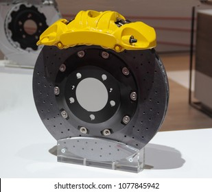 The close up of brake system with yellow caliper cover.