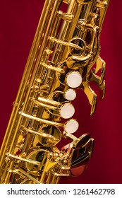 Close up of brass saxophone bell, body, neck and keys