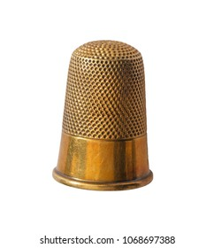 close up of brass thimble isolated on white background