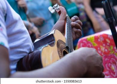 Close up of a brazilian small guitar (cavaquinho). Instrument used to play samba.