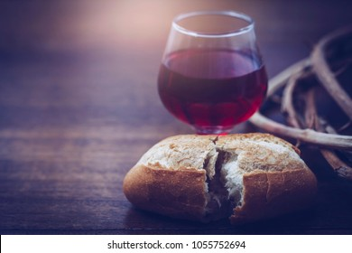 Close up of bread and a cup of Grape juice with crown of thorn on wooden table for communion, Christian concept for reminder of Jesus who died for human on the cross, Easter background, copy space
