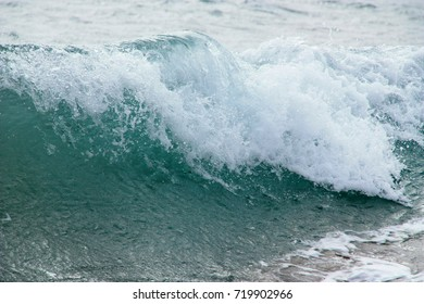 Close up of a breaking wave