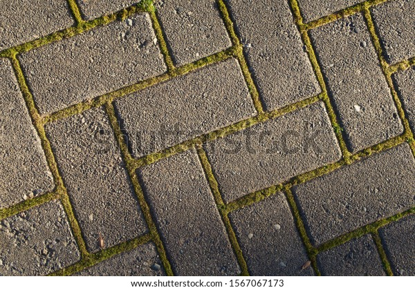 Close up of brick pavers layed out in criss-cross pattern for a pathway at a home.