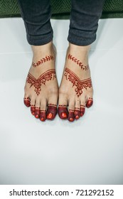 Close up of bride feet with henna. Selective focus