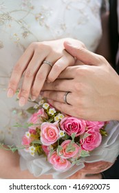 Close up bride and groom hand ware wedding ring