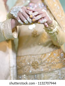 Close up Bride and groom holding hands, Indonesia Wedding Dress