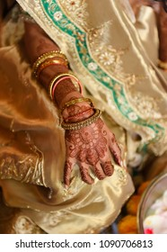 close up of bride with henna tattoo and gold bracelets