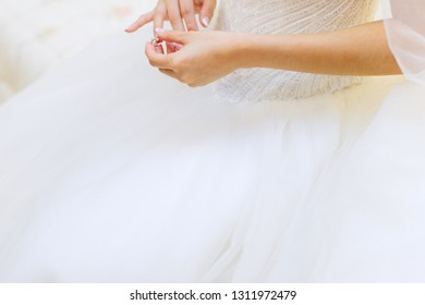 close up of a bride putting on her wedding ring