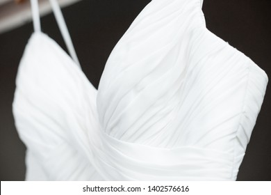 Close up of brides beautiful elegant wedding dress fabric and texture