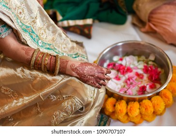 close up of bride's hand and arm with henna tattoo