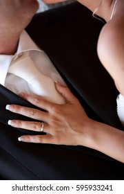 Close up of the bride's hand tenderly abandoned to the groom.