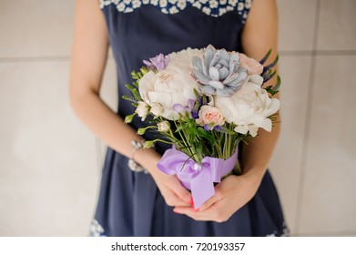 Close up bright bouquet of beautiful and colorful flowers on the grey background