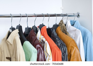 close up of bright clothes on hangers