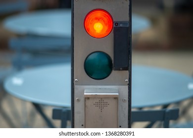 close up of bright red stop light with blurred background