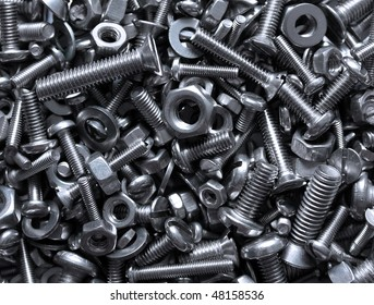 close up of bright and shiny nuts, bolts and washers -