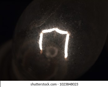 close up of bright white light bulb filament macro